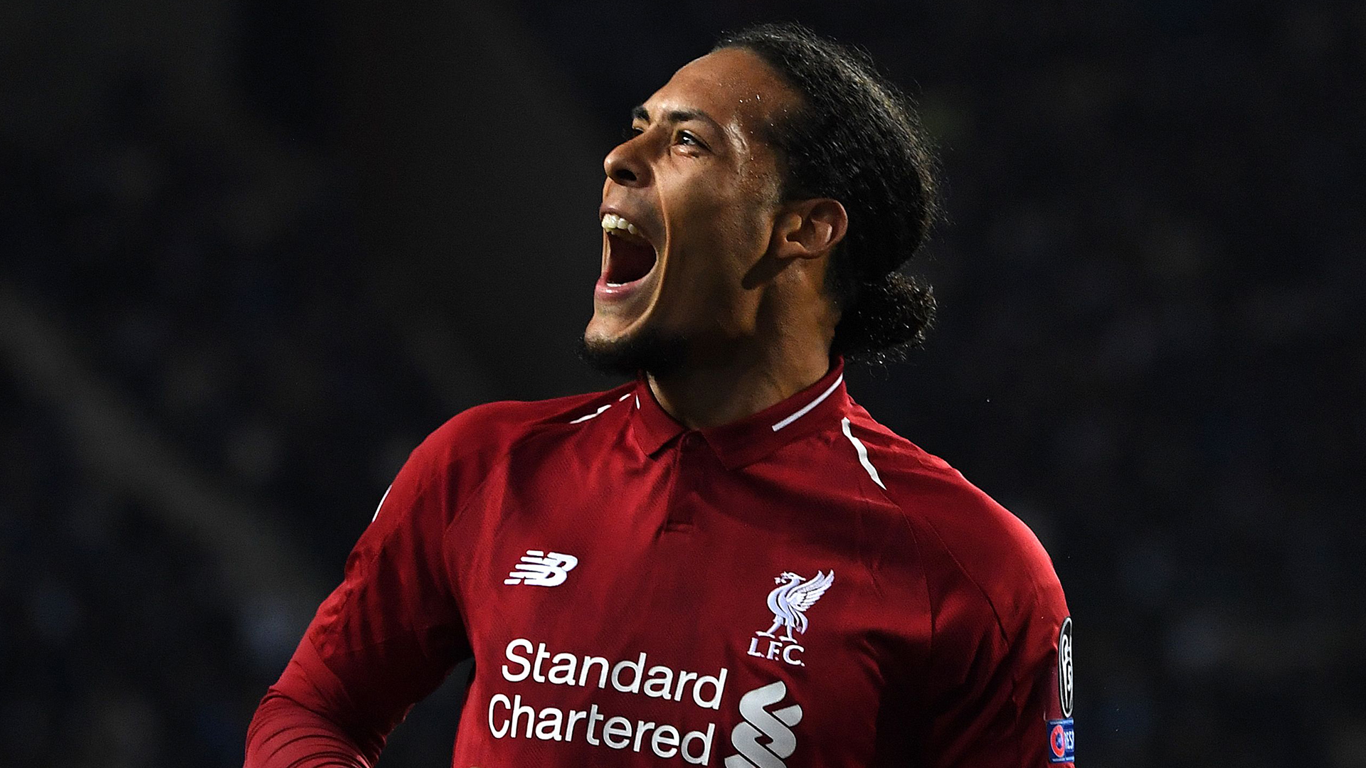 Liverpool's Dutch defender Virgil van Dijk celebrates after scoring his team's fourth goal during the UEFA Champions League quarter-final second leg football match between FC Porto and Liverpool at the Dragao Stadium in Porto on April 17, 2019. (Photo by Paul ELLIS / AFP)        (Photo credit should read PAUL ELLIS/AFP/Getty Images)